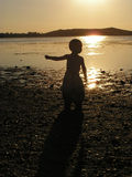 Child dancing in the sunset Stock Photos