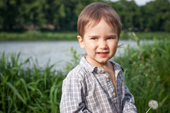 Child with dandelion outdoor Royalty Free Stock Photos