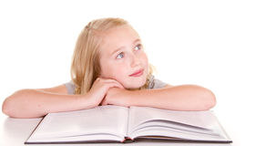 Child daydreaming while reading Royalty Free Stock Photography