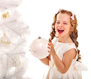 Child decorate Christmas tree. Royalty Free Stock Photography