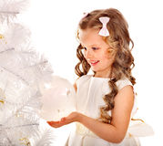 Child decorate Christmas tree. Stock Photo