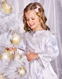Child decorate Christmas tree. Royalty Free Stock Photo