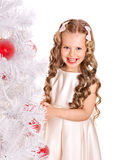 Child decorate Christmas tree. Stock Photos