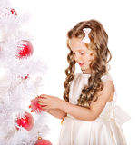 Child decorate Christmas tree. Stock Image