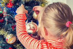 Child decorate  Christmas tree Royalty Free Stock Photo