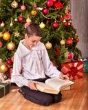 Child decorate on Christmas tree Royalty Free Stock Photos