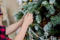 Child decorate a Christmas tree Royalty Free Stock Images