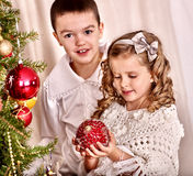 Child decorate on Christmas tree Royalty Free Stock Photo