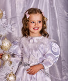 Child decorate Christmas tree. Xmas holiday. Stock Photography