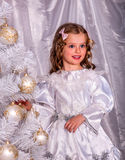 Child  and decorate white Christmas tree Stock Images