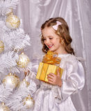 Child decorate white Christmas tree Royalty Free Stock Photo