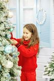 The child decorates a Christmas tree. Concept New Year, Merry Ch Stock Images