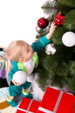 Child decorates a Christmas tree. New Year balls Royalty Free Stock Photos