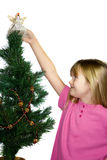 Child decorating Christmas tree. royalty free stock images