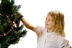 Child decorating a Christmas tree. Royalty Free Stock Photography