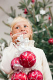 Child decorating the Christmas tree Royalty Free Stock Photo
