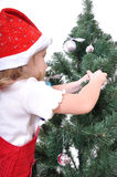 Child decorating Christmas tree Royalty Free Stock Photos
