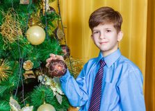 Child decorating the Christmas tree Royalty Free Stock Photos