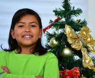 Child decorating a Christmas tree Stock Images