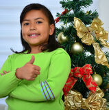 Child decorating a Christmas tree Royalty Free Stock Photos