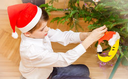 Child decorating the Christmas tree Stock Photo