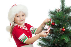 Child decorating Christmas tree isolated Royalty Free Stock Image