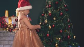 Child decorating Christmas tree. Kid celebrating Merry Christmas 2016 stock video