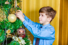 Child decorating the Christmas tree Stock Image