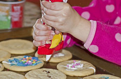 Child Decorating Cookies Royalty Free Stock Photos