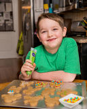 Child decorating ginger bread man Stock Images