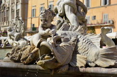 Child deity taming a Monster Fish. Detail of the beautiful Fountain of Neptune in Piazza Navona, Rome Stock Images