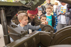 Child during demonstration of the military and rescue equipment Royalty Free Stock Image