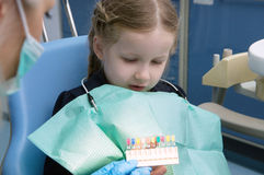 The child dental picks colored fillings Stock Photography