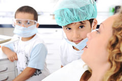 Child Dentists teeth checkup Stock Image