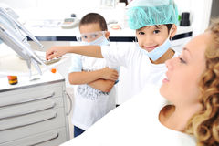 Child Dentists teeth checkup Stock Photography