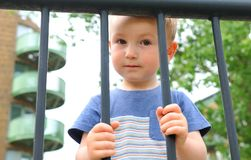 Child depression. Concept with boy behind the bars Stock Image