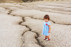 Child in a desert land Stock Image
