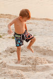 Child destroy sand castle. Child destroy sand castle stand summer childhood stock photos