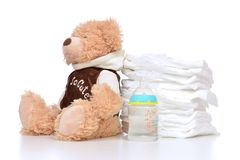 Child diapers baby feeding bottle teddy bear toy Royalty Free Stock Photography