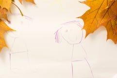 Child& x27; dibujo de s y hoja de arce del otoño Imagen de archivo libre de regalías