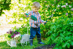 Child digging in the garden Royalty Free Stock Image