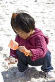 Child digging for treasure Stock Images