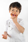 Child dirty with cake Stock Photography