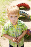 Child with dirty face and hands outdoor. At playground. Alone and sad. Summer spring season. Unhygienic conditions Royalty Free Stock Photos