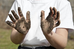 Child with dirty hands Royalty Free Stock Photography