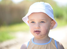 Child dirty mouth by mulberries Royalty Free Stock Image