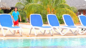 Child diving in resort swimming pool in summer stock footage