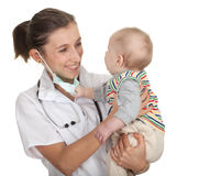 Child at doctor. Female doctor examining baby boy Royalty Free Stock Image