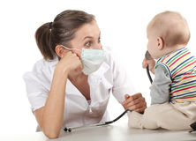 Child at doctor. Female doctor examining baby boy Royalty Free Stock Photo