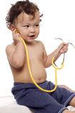 Child at the doctor. Child at the doctor,playing with stethoscope Royalty Free Stock Photos